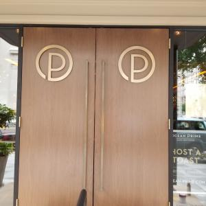 Brass Logo Installation - Restaurant Front Doors